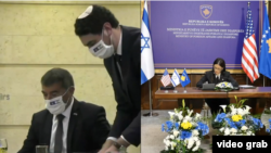 Israel's Foreign Minister Gabi Ashkenazi and Kosovo's Foreign Minister Meliza Haradinaj Stublla attend a virtual ceremony to sign an agreement establishing diplomatic relations between Israel and Kosovo.