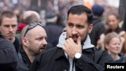 Alexandre Benalla, a French presidential security aide fired Friday, is seen during a May Day labor union rally in Paris, France, May 1, 2018.