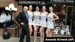 What is one of the beautiful English words? (The Radio City Rockettes are standing in front of a clue!)