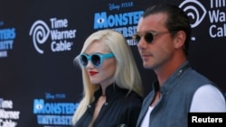 """FILE - Musician Gwen Stefani (L) and her husband singer Gavin Rossdale pose at the premiere of the film """"Monsters University"""" at El Capitan theater in Hollywood, California."""