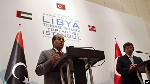 Libyan rebel leader and senior member of Libya's National Transitional Council (NTC) Mahmoud Jibril, speaks during a joint news conference with Turkey's FM Ahmet Davutoglu (R) in Istanbul, August 26, 2011