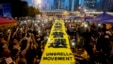 "Pro-democracy protesters spread a yellow banner with the words reading: ""I want genuine universal suffrage"" at a rally in the occupied areas outside government headquarters in Hong Kong's Admiralty, Oct. 28, 2014."