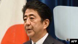 Japanese Prime Minister Shinzo Abe delivers a war anniversary statement that neighboring nations will scrutinize for signs of sufficient remorse over Tokyo's past militarism at his official residence in Tokyo, August 14, 2015.