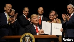 U.S. President Donald Trump is applauded after signing an Executive Order on US-Cuba policy in Miami, Florida, U.S. (File)