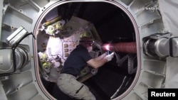 NASA astronaut Jeff Williams works inside the Bigelow Expandable Activity Module (BEAM) attached to the International Space Station in this still image from NASA TV taken June 6, 2016.