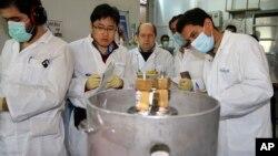 Xalqaro Atom energiyasi agentligi vakillari Erondagi Natanz yadro inshootini ko'zdan kechirmoqda, 20-yanvar, 2014-yil.