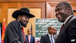 FILE - In this photo dated June 21, 2018, South Sudan's President Salva Kiir, left, and opposition leader Riek Machar, right, shake hands during peace talks in Addis Ababa, Ethiopia.