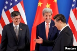China's President Xi Jinping, right, meets with U.S. Secretary of State John Kerry, center, and U.S. Treasury Secretary Jack Lew during the joint opening ceremony of the 8th round of U.S.-China Strategic and Economic Dialogues, in Beijing, June 6, 2016.