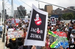 FILE - Demonstrators take part in a protest march across the Nelson Mandela bridge into Johannesburg, Dec. 16, 2015. Protesters were calling for President Jacob Zuma to be removed amid allegations of corruption.