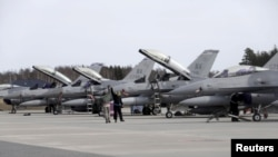 FILE - U.S. Air Force 510th Fighter Squadron F-16 fighters are seen parked on tarmac in Amari air base, in Estonia. Lockheed Martin says talks are being held between the American and Indian governments on its proposal to manufacture F-16 fighter jets in India.