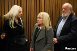 June and Barry Steenkamp leave the court after the sentence hearing of Olympic and Paralympic track star Oscar Pistorius at the North Gauteng High Court in Pretoria, South Africa, July 6, 2016.