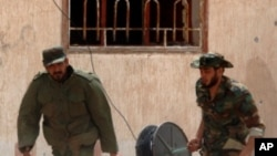 لیبیا: جنگ بندی کی اپیل غیر موثر، سرکاری افواج کی بمباری جاری