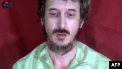 Handout photo released Oct. 4, 2012 by the SITE Monitoring Service shows French secret agent Denis Allex held hostage in Somalia urging French President to negotiate his release.