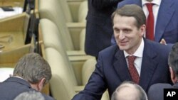 Deputies of the United Russia party congratulate Sergei Naryshkin (R), newly elected speaker of Russia's State Duma, during the first session of the lower house of parliament in Moscow, December 21, 2011.