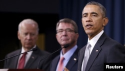 FILE - U.S. President Barack Obama delivers remarks after a National Security Council meeting on the counter-Islamic State campaign, accompanied by U.S. Vice President Joe Biden (L) and U.S. Defense Secretary Ash Carter (C) in Washington on Dec. 14, 2015.