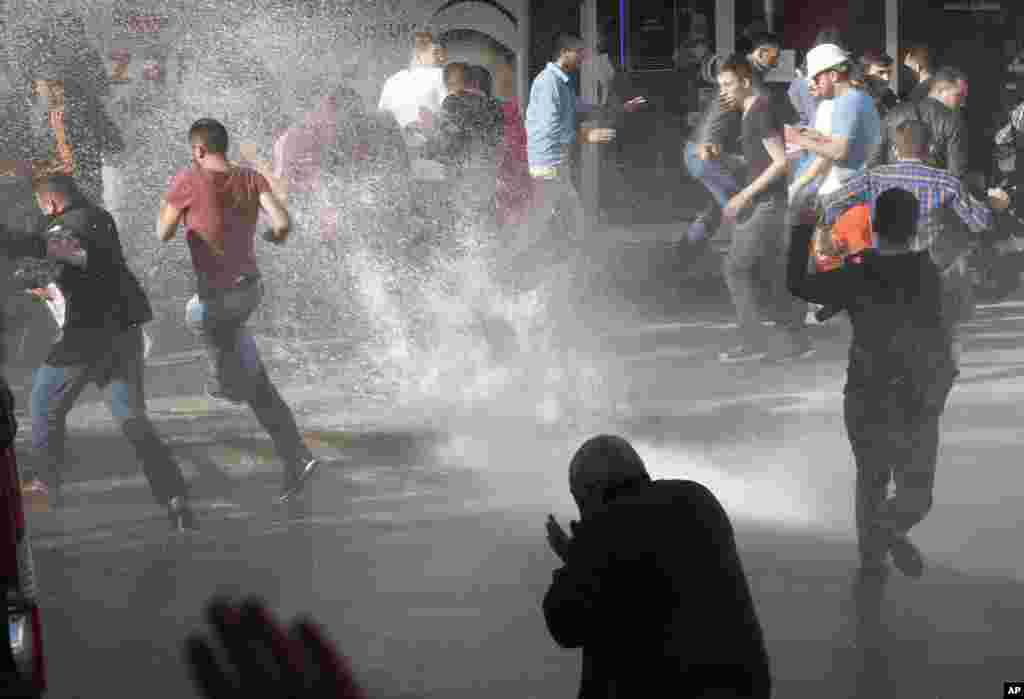 A police water cannon is used against anti-government protesters in Soma, Turkey, May 16, 2014.