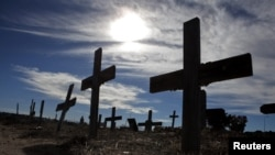 Crosses fill a graveyard in Cape Town's Khayelitsha township. Many of those buried in the South African cemetery died from AIDS or related complications such as tuberculosis.