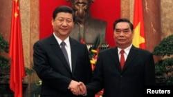 Đặc phái viên Lê Hồng Anh Lê Hồng Anh và Chủ tịch Trung Quốc Tập Cận Bình.
