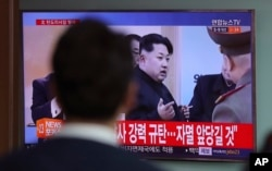 A man watches a TV news program showing a file footage of North Korean leader Kim Jong Un, at Seoul Train Station in Seoul, South Korea, Wednesday, April 5, 2017.