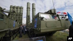 FILE - Russian air defense missile systems are displayed at the MAKS Air Show in Zhukovsky, outside Moscow, Aug. 27, 2013.