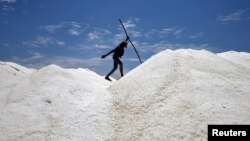 India is the world's third largest salt producing country in the world. Here, a worker walks through a mountain of salt near the southern Indian city of Chennai in April 2014.