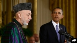 奧巴馬(右)與阿富汗總統卡爾扎伊(左)