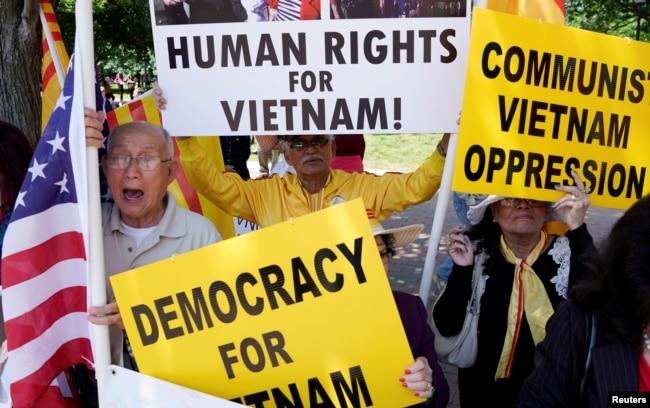 FILE - Vietnamese Americans protest outside the White House before U.S. President Donald Trumps meeting with Vietnamese Prime Minister Nguyen Xuan Phuc at the White House in Washington.