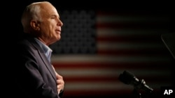 FILE - Then-Republican presidential candidate Sen. John McCain speaks at a rally in Davenport, Iowa, Oct. 11, 2008.