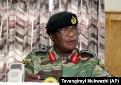 FILE: Zimbabwe's Army Commander, Constantino Chiwenga addresses a press conference in Harare, Monday, Nov. 13, 2017. The army commander Monday criticized the instability in the country's ruling party caused by President Robert Mugabe.