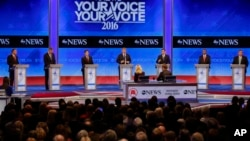 Republican presidential candidates line up on the stage at the beginning of a Republican presidential primary debate hosted by ABC News at the St. Anselm College, Feb. 6, 2016, in Manchester, New Hampshire.