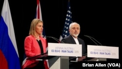 European Union foreign policy chief Federica Mogherini and Iranian Foreign Minister Mohammad Javad Zarif announce a landmark deal to curb Iran's nuclear program in exchange for relief from international sanctions in Vienna, Austria, July 14, 2015.