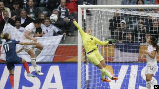 United States' Abby Wambach scores her side's second goal during the semifinal match between France and the United States at the Women's Soccer World Cup in Moenchengladbach, Germany,  July 13, 2011