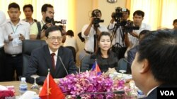 Var Kim Hong, chairman of the Cambodian Government Border Committee, talks to his Vietnamese counterpart, H.E. Ho Xuan Son, Deputy Minister of Foreign Affairs in a close door bilateral meeting at Council of Ministers in Phnom Penh, Cambodia, July 7, 2015
