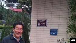Chientan borough chief Bi Wu-liang shows an outdoor dog toilet as part of an eco-friendly park in his part of Taipei.