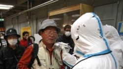 People being tested Tuesday for radiation exposure in Koriyama city near the damaged Fukushima nuclear power plant