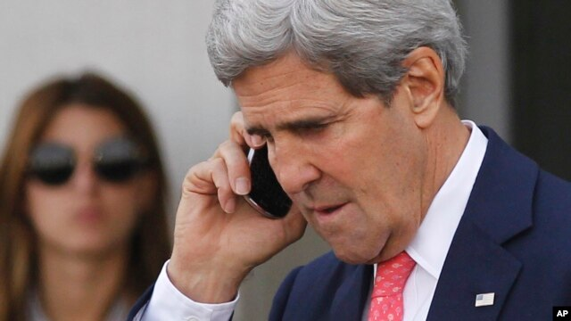 U.S. Secretary of State John Kerry speaks on a mobile phone after meeting with Israeli Prime Minister Benjamin Netanyahu in Tel Aviv, Israel, Nov. 8, 2013.