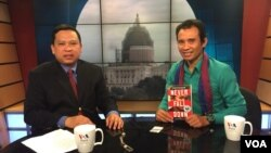 Mr. Arn Chorn-Pond, founder of Cambodian Living Arts, gives during an interview with Sok Khemara at a VOA studio in Washington, D.C on Monday, April 27, 2015. Cambodian Living Arts helps to preserve the Cambodian cultures and arts through trainings, perfo