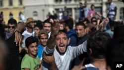 A man shouts during a protest at the Keleti train station in Budapest, Sept. 4, 2015.