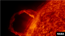 "Solar Flare. This extreme ultraviolet emission line is from singly ionized Helium, or He II, and corresponds to a temperature of approx. 50,000 degrees Celsius."" (NASA)"