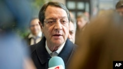 Cypriot President Nicos Anastasiades speaks with the media after an emergency eurogroup meeting in Brussels, March 25, 2013.