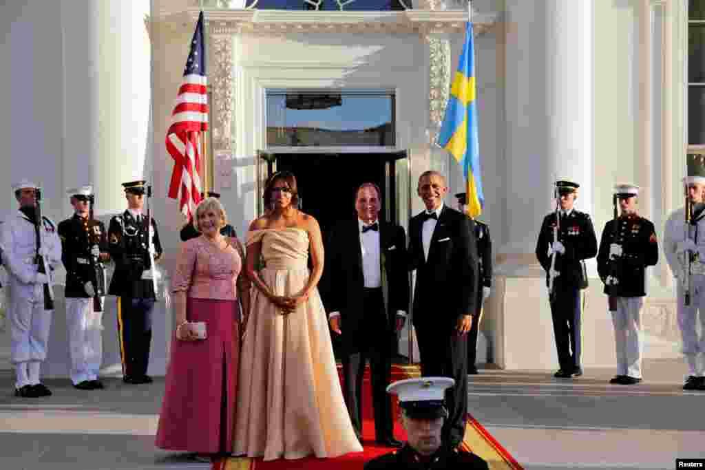 اوباما و همسرش از نخست وزیر سوئد استقبال می کنند.