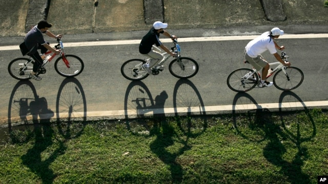 FILE - Cyclists cruise down a bike path in Taipei, Taiwan.
