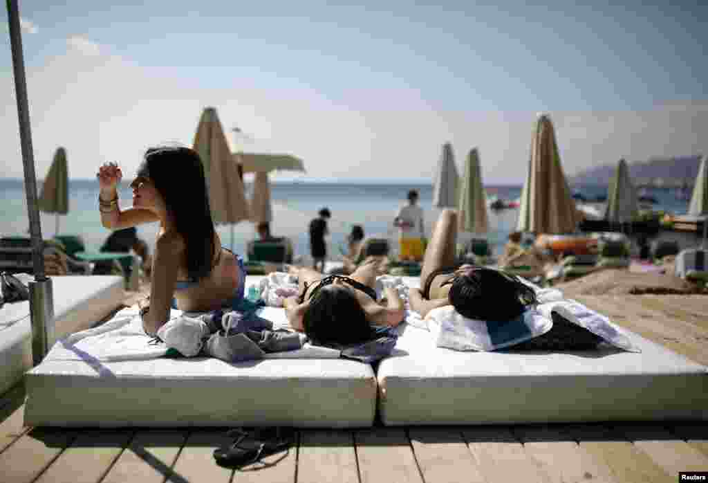 Tourists sunbathe on the beach in the Red Sea resort city of Eilat, one of Israel's most popular holiday spots.