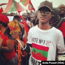 A young supporter of Angola's largest opposition party, UNITA, brought his chicken — which is also the party's mascot — to the party's final pre-vote rally in the capital, Luanda.