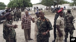 Somali military chief Gen. Dini, center, arrives at the scene of an explosion in Mogadishu, Nov. 30, 2011.