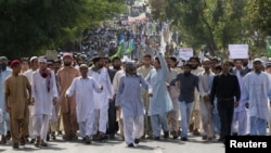 Protesters shout slogans as they march towards the U.S. Embassy during an anti-America rally in Islamabad, September 21, 2012.