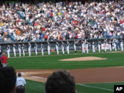 Nine of the Chicago White Sox' 25 players, shown here at attention during the playing of the U.S. national anthem, are Latinos. None is of Asian heritage.