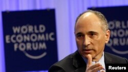 FILE - Chief Executive Officer of Novartis Joseph Jimenez speaks during a session at the World Economic Forum in Davos Jan. 25, 2014.