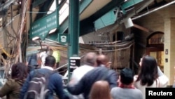 Onlookers view a New Jersey Transit train that derailed and crashed through the station in Hoboken, New Jersey, in this picture courtesy of Chris Lantero, taken Sept. 29, 2016.
