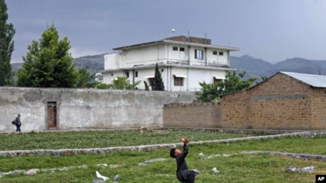 A boy plays with a tennis ball in front of Osama bin Laden's compound in Abbottabad, Pakistan, May 2011. (file photo) Osama bin Laden was killed almost a year ago, on May 2, 2011, by a United States special operations military unit in a raid on his compou